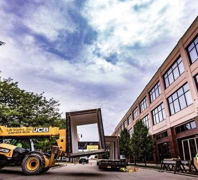 Photo courtesy of Peer Canvas Photography. This shows CCI moving one of the twenty-four shipping containers that were loaded into Irontek before being transformed into unique office spaces.