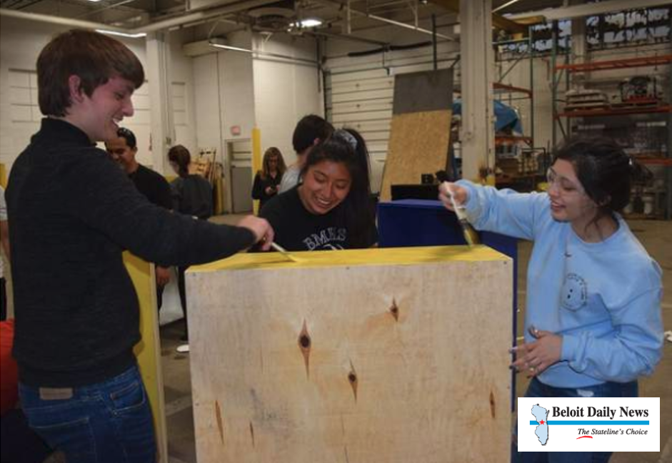 CCI helps students build bookcases for literacy
