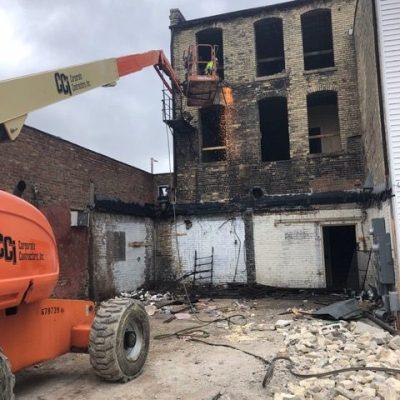 Janesville demolition underway to rebuild apartments above two storefronts