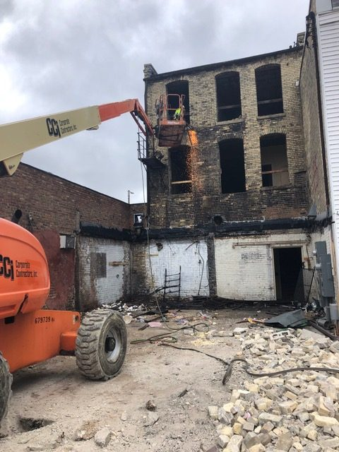 Janesville demolition underway to rebuild apartments above two storefronts